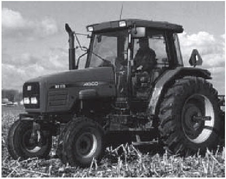 Figure 2. A ROPS with enclosed cab gives the operator the most protection from common hazards of tractor operation.