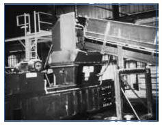 Figure 5. Automatic conveyor-fed horizontal baler.