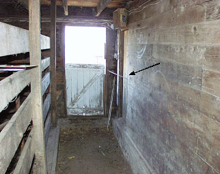 Photo #1.  Looking south towards vet room door indicated by arrow.