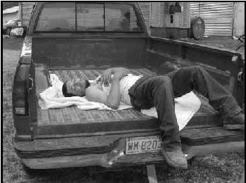 Jaun lays down in a truck