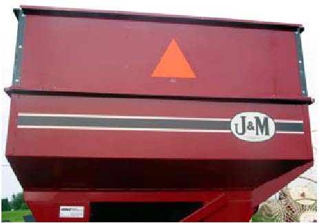 Photo 1: A properly placed SMV emblem that is clean, bright, and not obstructed. The red-orange fluorescent equilateral triangle should be the most obvious feature of the emblem
