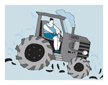 Person on tractor kicking up dirt