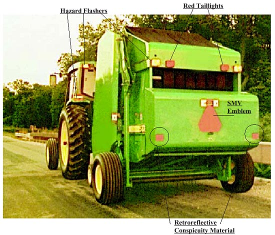 tractor with hazard flashers, red taillights, smv emblem, and retroflective conspicuity material