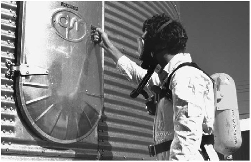 Man entering silo with respiratory gear