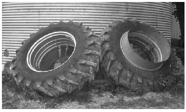 wheels leaning against silo