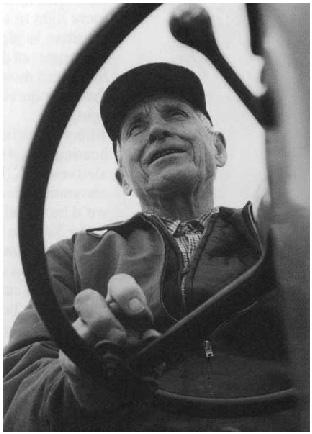 man behind steering wheel
