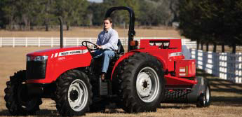 Photo of a man on a tractor with a 2 post rops