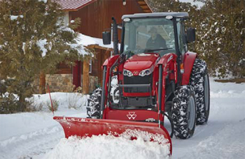 Photo of a tractor plowing snow