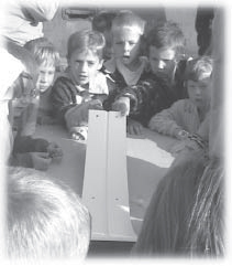 picture of students using the marbles and sloping board