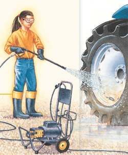 A young girl cleaning tractor tires with a pressure washer