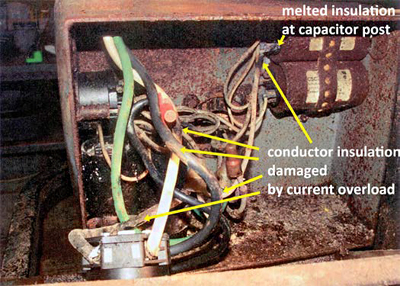 This is a picture of the melted insulation at capacitor post and other damage from the current overload
