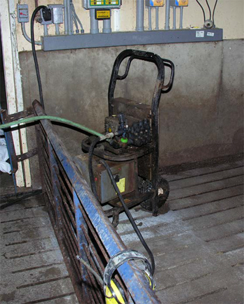 This is a picture of the pressure washer plugged into wall receptacle at the site.