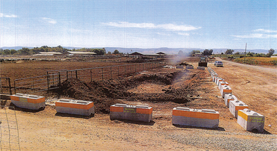 Storage of manure with solid barriers encircling