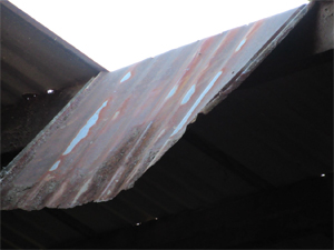 Close up of the corrugated metal part of the roof that came loose.