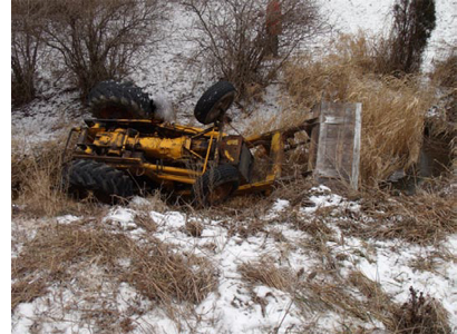FIGURE 1. TRACTOR OVERTURNED IN DITCH